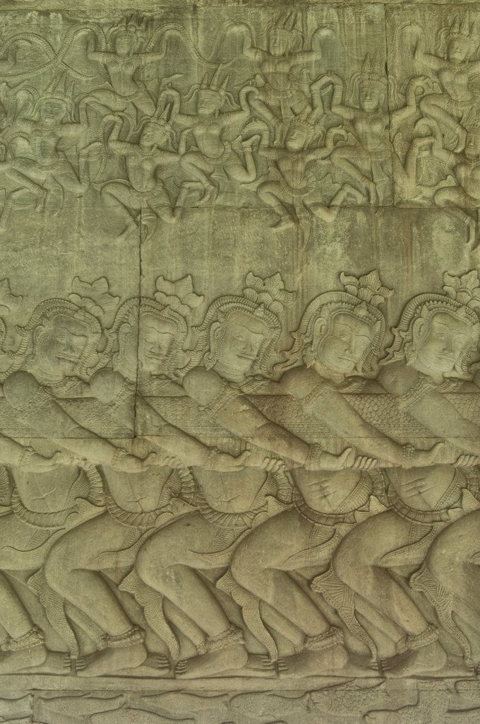 Stock Photo: 4168-11740 Cambodia, Angkor, Angkor Wat, East Gallery, Bas-Relief Scene Of The Churning Of The Ocean Of Milk, Apsaras Above