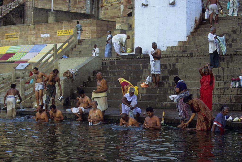 India, Varanasi, Ganges River, Pilgrims Washing In River : Stock Photo