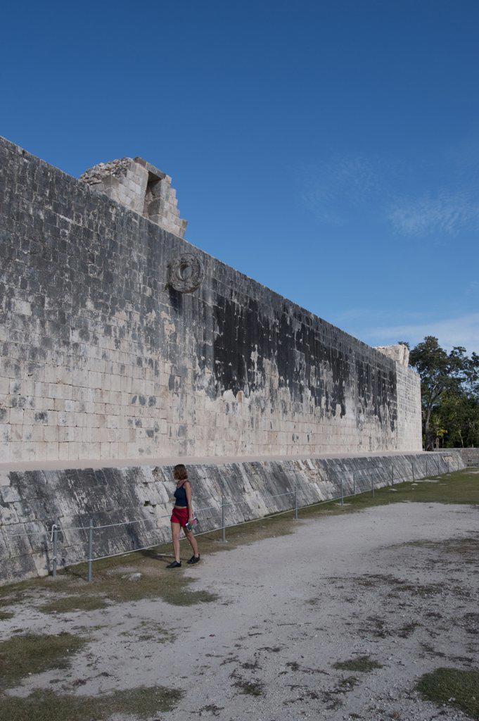 Stock Photo: 4168-12610 Mexico, Yucatan Peninsula, Near Cancun, Maya Ruins Of Chichen Itza, The Great Ball Court, Tourist