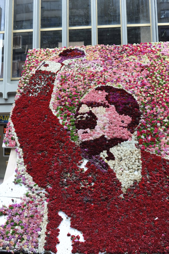 Stock Photo: 4168-13156 Floral Mosaic Of Jorge Eliécer Gaitán Ayala On The Spot Of His Assassination In La Candelaria, The Old Town Of Bogota, Colombia
