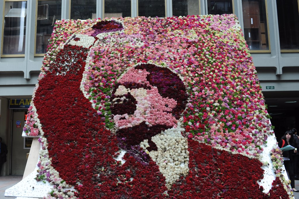 Stock Photo: 4168-13157 Floral Mosaic Of Jorge Eliécer Gaitán Ayala On The Spot Of His Assassination In La Candelaria, The Old Town Of Bogota, Colombia