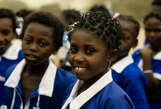 GAMBIA, JAMBUR VILLAGE, INDEPENDENCE CELEBRATION, PORTRAIT OF LOCAL SCHOOLGIRL : Stock Photo