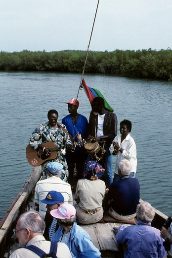GAMBIA, GAMBIA RIVER DELTA MANGROVE SWAMPS, TOURIST ON BOAT EXCURSIONS : Stock Photo