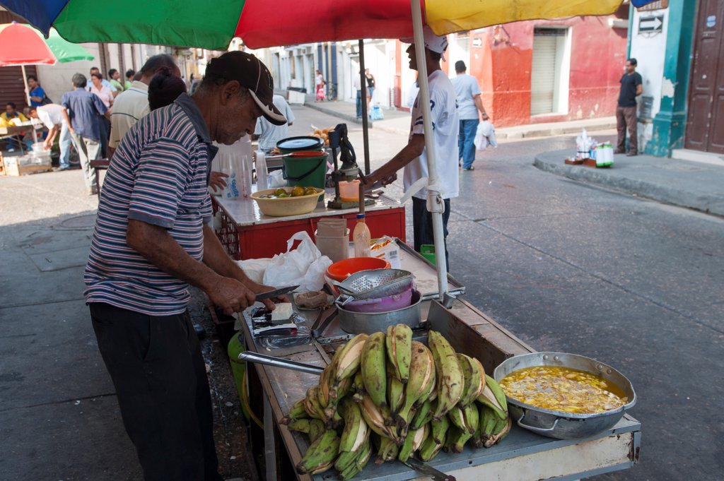 Stock Photo: 4168-14701 Street Vendor Preparing Fried Plantains In The Streets Of Cartagena, Colombia