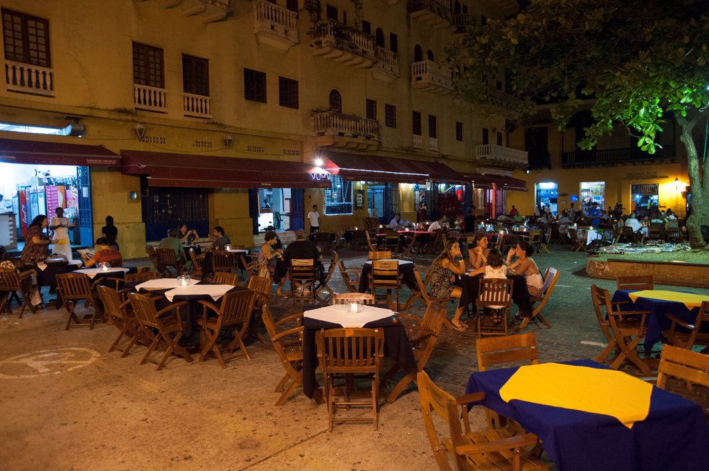 Outdoor Restaurants At Night On Plaza Santo Domingo In Cartagena, Colombia, A Walled City And Unesco World Heritage Site : Stock Photo