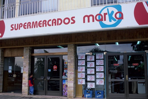 Stock Photo: 4168-2860 Argentina, Bariloche, Supermarket With Signs Advertising Specials In Window