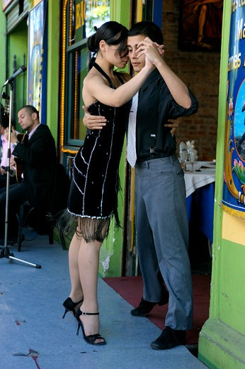 Stock Photo: 4168-3106 Argentina, Buenos Aires, La Boca, Sidewalk Restaurant, Young People Dancing The Tango, Model Released (Sonia 20101012-1, Lucas 20101012-2)