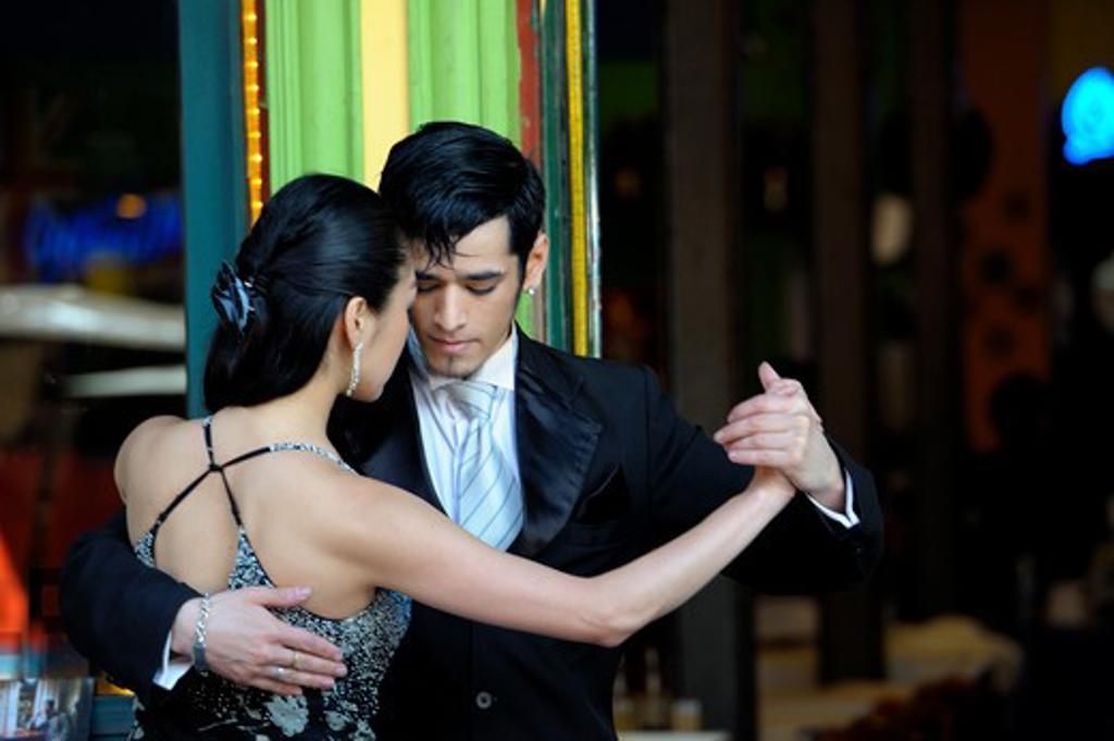 Argentina, Buenos Aires, La Boca, Sidewalk Restaurant, Young People Dancing The Tango, Model Released (Yuki 20101012-5, Juan 20101012-4) : Stock Photo