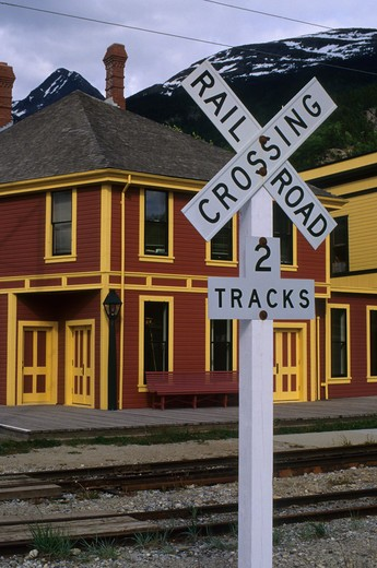 Stock Photo: 4168-3398 Usa, Alaska, Inside Passage, Skagway, White Pass-Yukon Route Railway Station, Railroad Crossing Sign