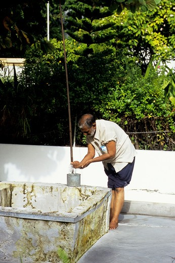 maldives, male, friday mosque (hukuru miski), man washing before pray : Stock Photo