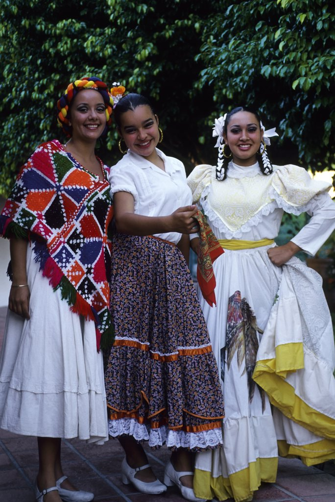 MEXICO, BAJA CALIFORNIA, LA PAZ, FIESTA, YOUNG WOMEN IN TRADITIONAL DRESS : Stock Photo