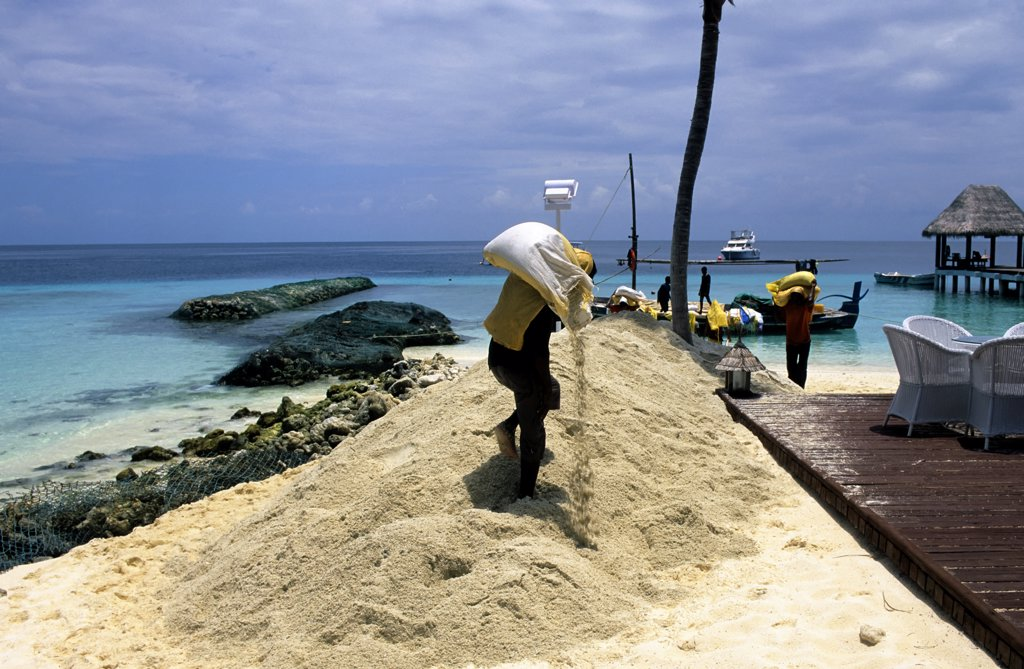 Maldives, Taj, Boat delivering sand : Stock Photo