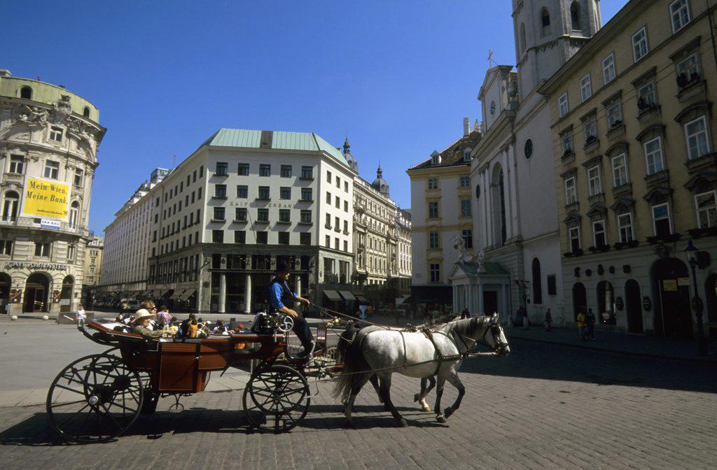 Stock Photo: 4168-8143 Austria, Vienna, Fiaker crossing St Michael's Square