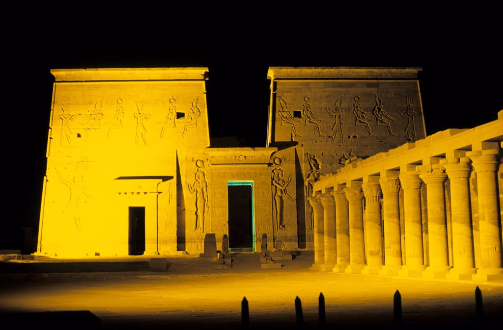 Egypt, Aswan, Nile River, Agilkia Island, Philae, Temple of Isis, First Pylon Illuminated at Nigh : Stock Photo