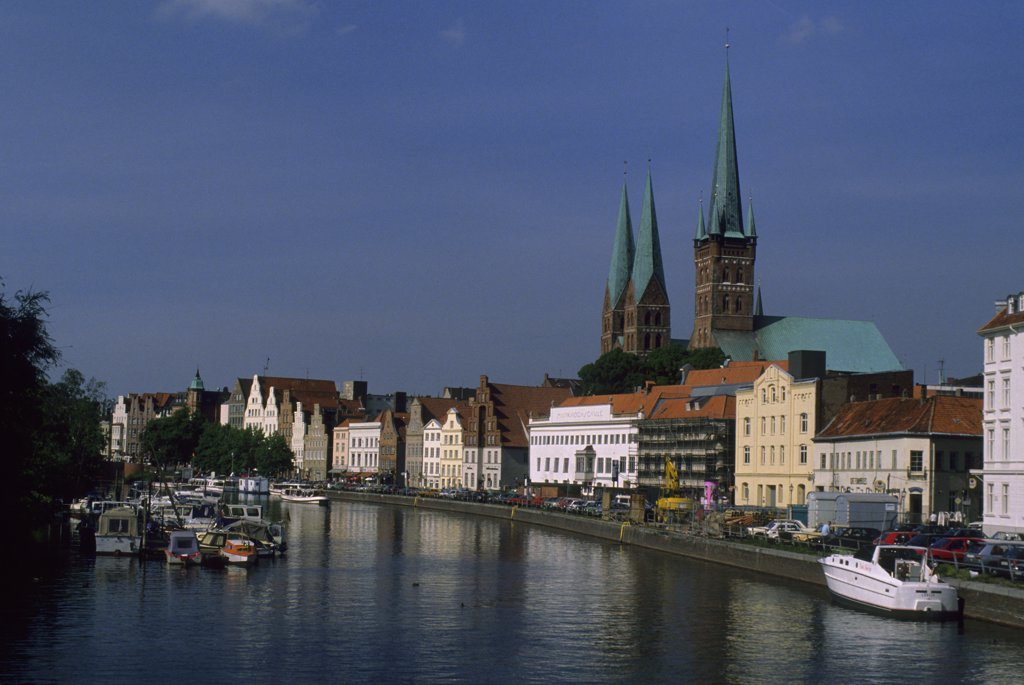 Germany, Lubeck, Upper Trave River with St. Petri And St. Mary's Churches : Stock Photo