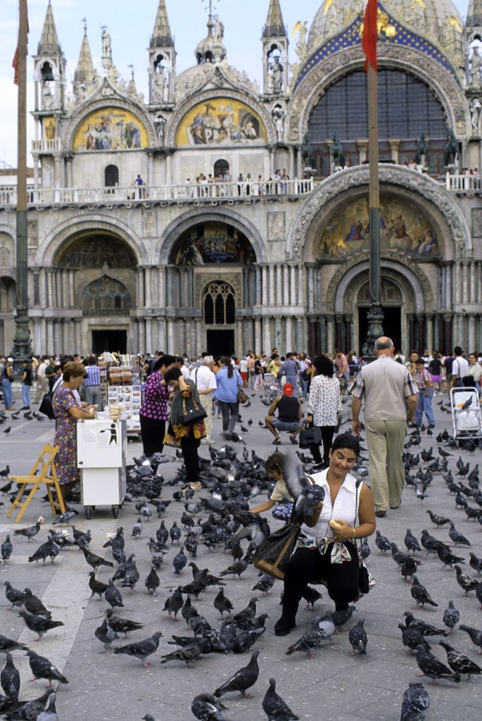 Stock Photo: 4168-8747 Italy, Venice, San Marco Quarter, St, Mark's Square, St. Mark's cathedral, Tourist feeding pigeons