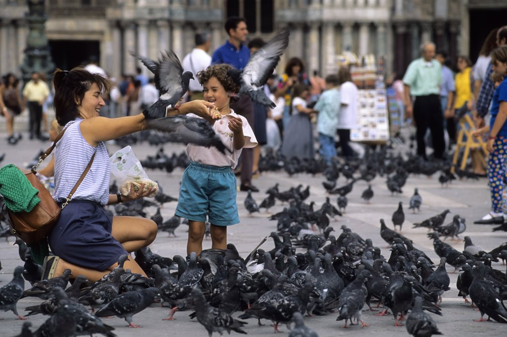 Stock Photo: 4168-8749 Italy, Venice, San Marco Quarter, St, Mark's Square, St. Mark's cathedral, Tourists feeding pigeons