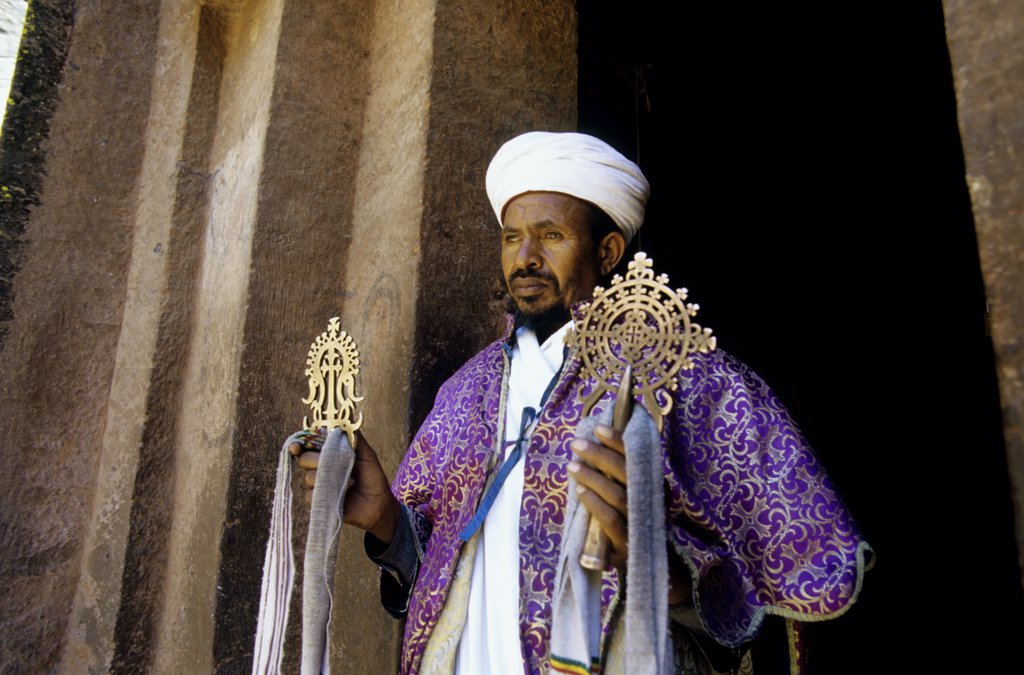Stock Photo: 4168-9143 Ethiopia, Lalibela, Unesco World Heritage Site,  Church Carved Into Rock, Cross Church, Priest With Cross, Close-Up