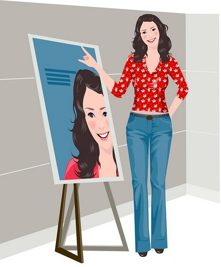 Portrait of a woman standing near a painting and smiling : Stock Photo