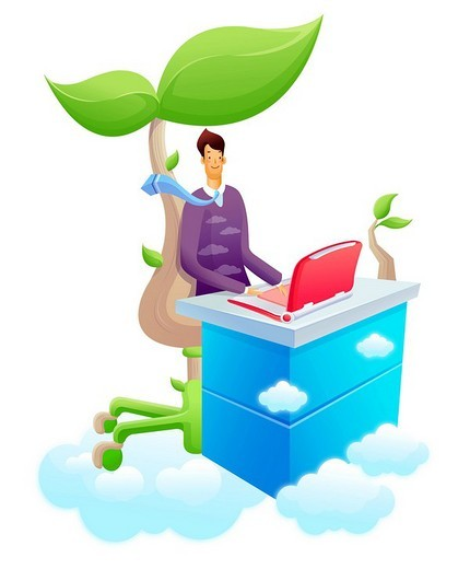Businessman using a laptop under a tree : Stock Photo