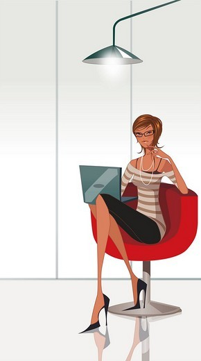 Stock Photo: 4170R-1886 Portrait of a businesswoman sitting on an office chair and using a laptop