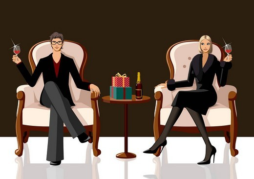 Couple sitting on armchairs and holding glasses of red wine : Stock Photo