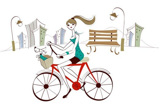 Side profile of a woman riding a bicycle : Stock Photo
