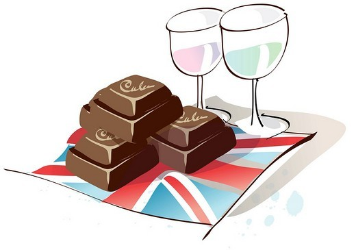 Two glasses of wine with chocolates on a British flag : Stock Photo