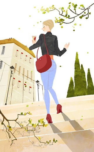 Young woman stepping toward the building holding the cold drink : Stock Photo