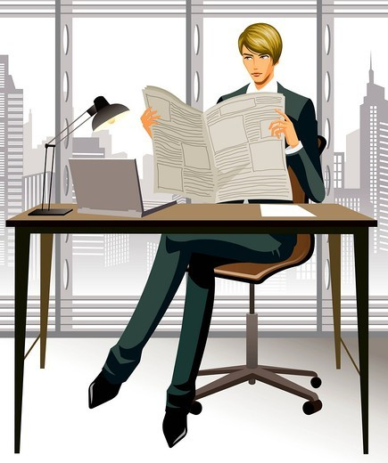 Businessman reading a newspaper in office : Stock Photo