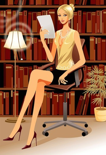 Businesswoman reading a document : Stock Photo