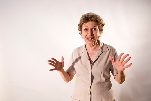 Excited elderly woman with wide grin : Stock Photo