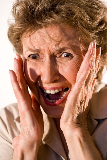 Stock Photo: 4172R-1062 Elderly woman with frightened look on her face
