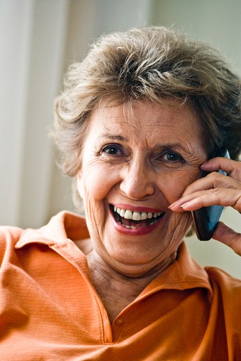 Close up of happy elderly woman on mobile phone : Stock Photo