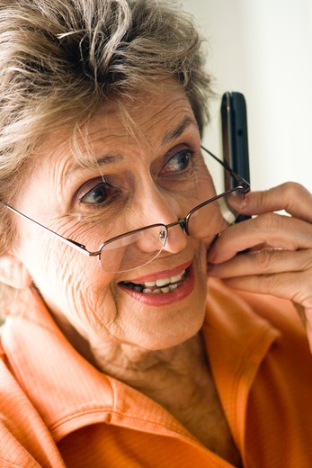 Stock Photo: 4172R-1078 Close up of happy elderly woman on mobile phone