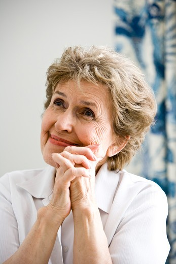 Close up of elderly woman thinking happy thoughts : Stock Photo