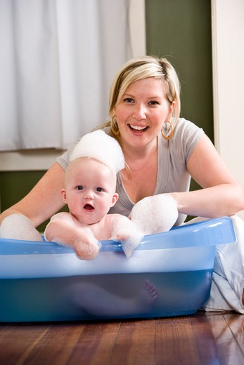 Stock Photo: 4172R-1101 Mother giving baby a bath