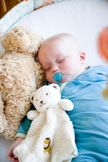 Stock Photo: 4172R-1106 Seven month old baby sound asleep in crib
