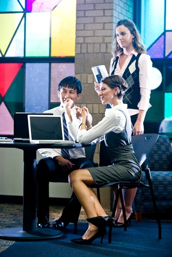 Young office workers in colorful meeting room : Stock Photo