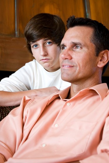 Closeup of father with teenage son at home : Stock Photo
