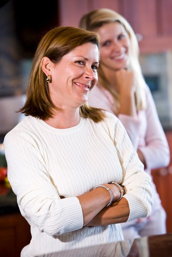Closeup of mother in kitchen with teenage daughter : Stock Photo