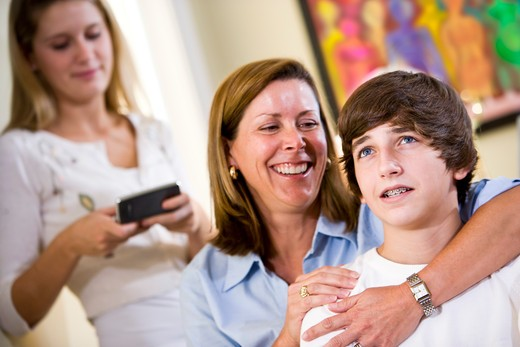 Stock Photo: 4172R-1719 Loving mother with arm around teenage son