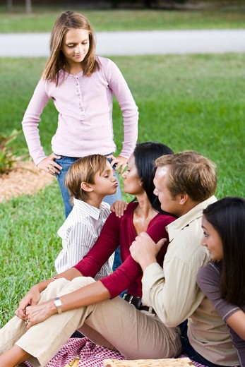 Stock Photo: 4172R-1859 Affectionate family of five together in park