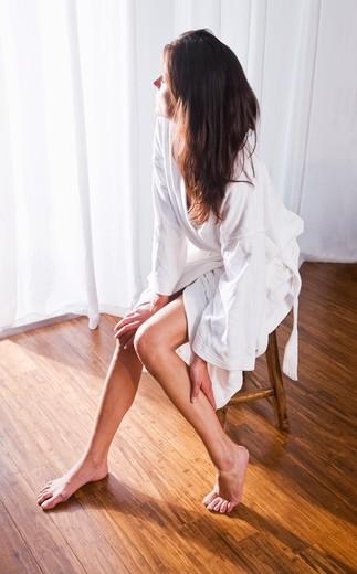 Stock Photo: 4172R-1993 Beautiful brunette woman wearing bathrobe