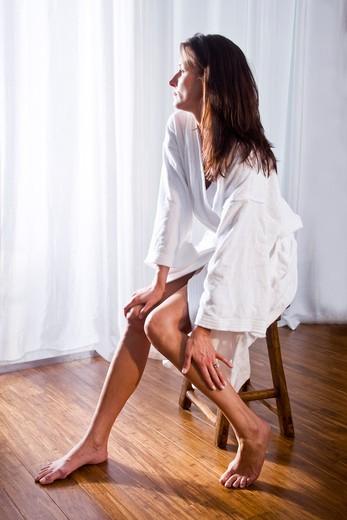 Stock Photo: 4172R-1995 Beautiful brunette woman wearing bathrobe