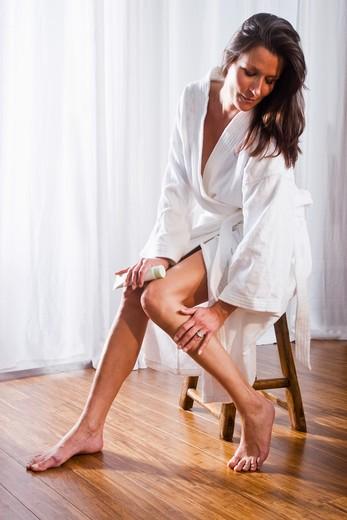 Beautiful brunette woman wearing bathrobe : Stock Photo
