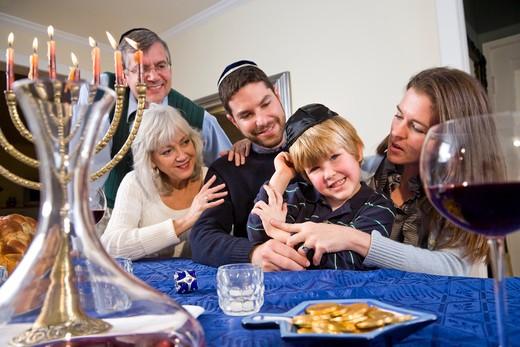 Stock Photo: 4172R-2063 Jewish family celebrating Chanukah