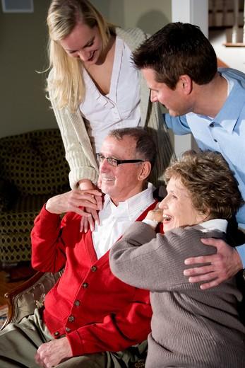 Stock Photo: 4172R-2240 Senior couple with adult children