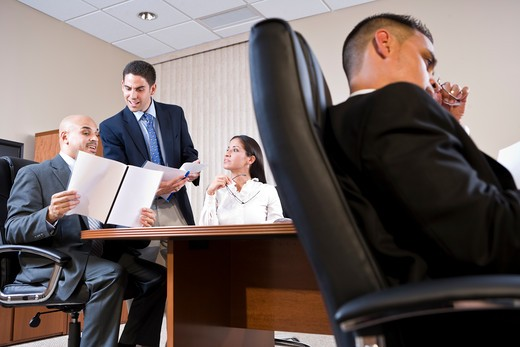 Stock Photo: 4172R-2335 Low angle view of business meeting in boardroom