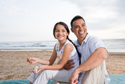 Stock Photo: 4172R-2360 Hispanic father and young daughter having fun at beach